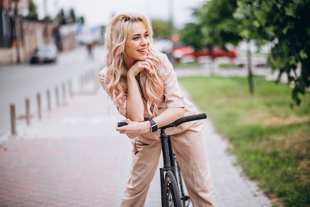 Woman on a bicycle with pink lips.