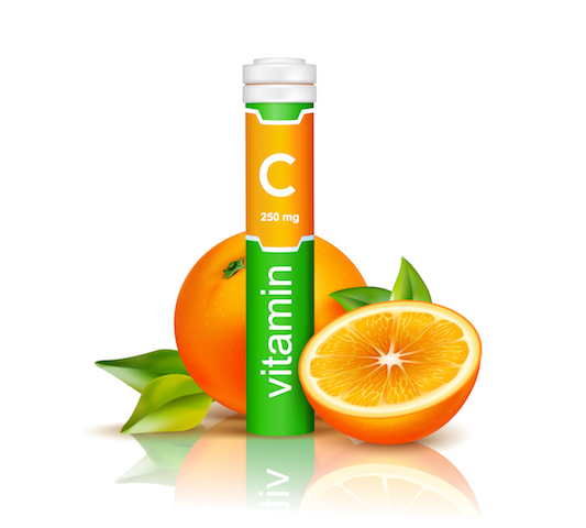 vitamin c tablets with oranges.