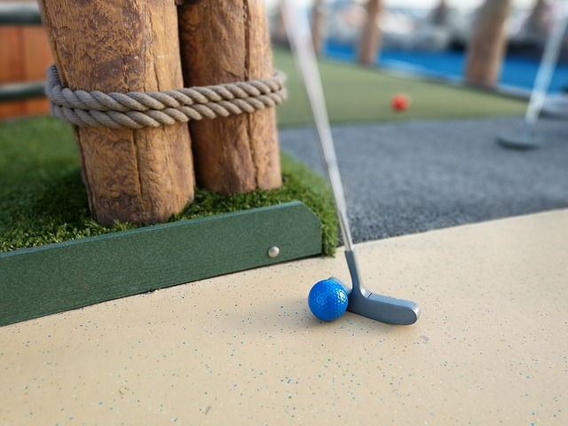 Two clubs at mini golf date.
