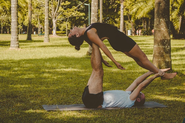 Couple workout out together in the park on a date.