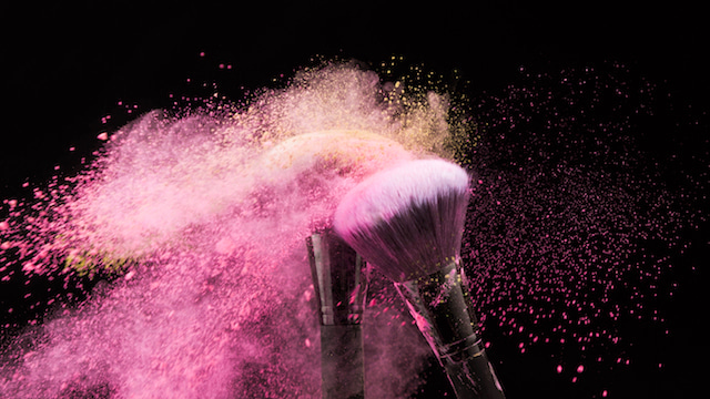 pink powder makeup on brushes.
