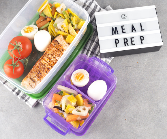 tupperware containers full of food for meal prep.