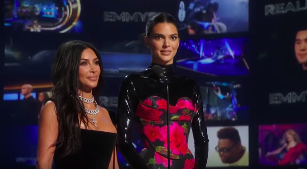 Kim Kardashian and Kendall Jenner looking not pleased while presenting during the Emmys.